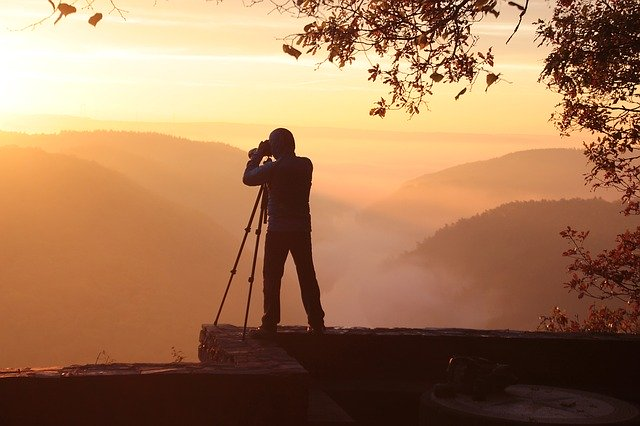 photographer-taking photo at sunset