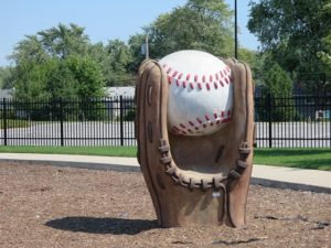 catchy business name idea featured statue of a baseball mit catching a baseball