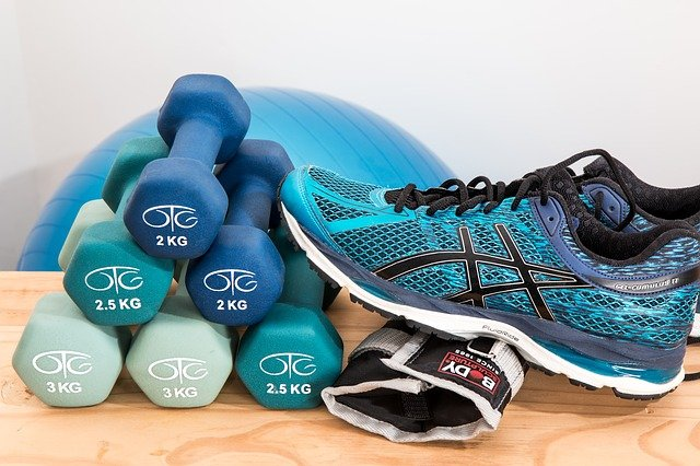dumbbells stacked with running shoe